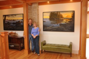 Happy couple in front of their commissioned artwork.